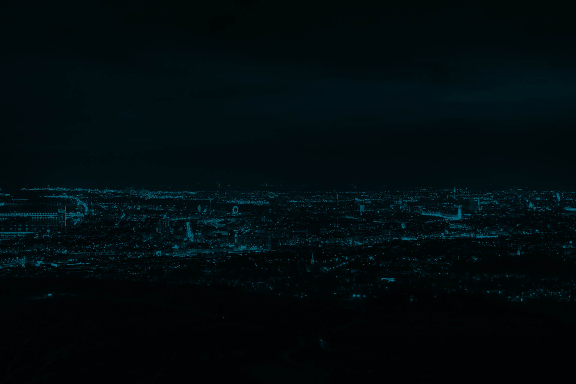 Aerial view of Vienna in the night with a lot of lights from buildings shining.